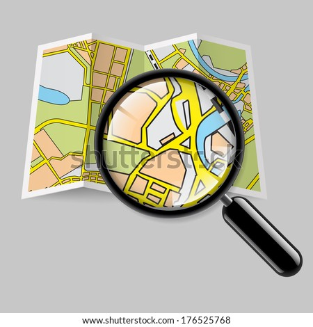 City map booklet with magnifying glass on grey background