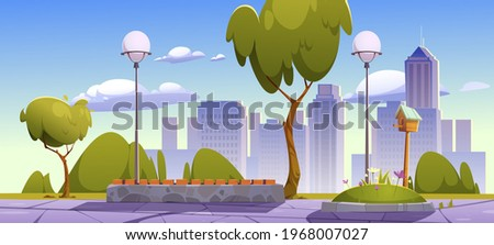 City park with green trees and grass, wooden bench and town buildings on skyline. Vector cartoon summer landscape of empty public garden with lanterns and birdhouse