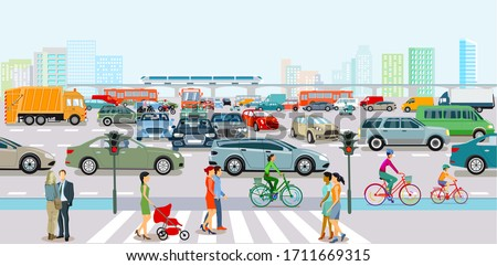 City with traffic in rush hour and pedestrians on the sidewalk stock photo