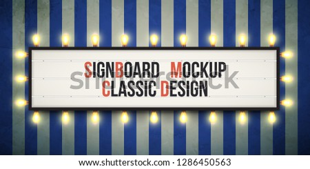 Classic sign board with changeable letters on grunge background. Traditional theater readograph sign. Cinema sign with amber fairground lights. Marquee sign with bulbs.