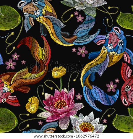 Classical embroidery koi carp, pink and white lotuses and water lilies, template fashionable clothes, t-shirt design. Embroidery koi fish and water lily seamless pattern, japanese pattern