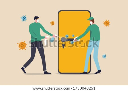 Cleaning or disinfect door handle to prevent Coronavirus COVID-19 outbreak concept, cleaning service workers spray disinfectant alcohol or sanitiser and using cloth to clean Coronavirus pathogens.