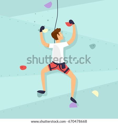 climbing wall guy is climbing