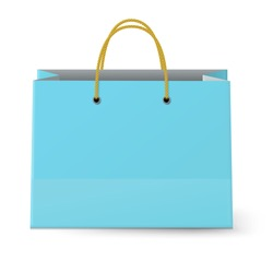 Close-up view of classic blue paper shopping bag with yellow rope grips isolated on white background