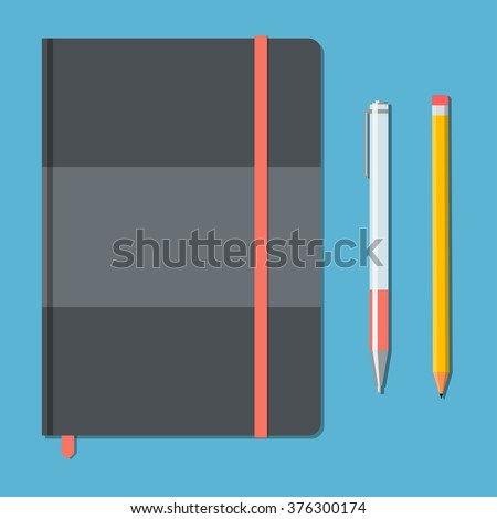closed notebook with pencil and