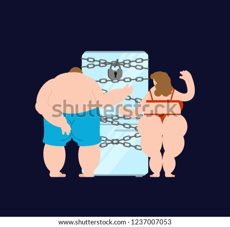 Closed refrigerator chain and fat couple family. Large padlock. Stop food eating. Glutton prohibited