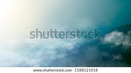 cloudscape with dark mountain