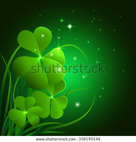 clover leaves and grass on dark
