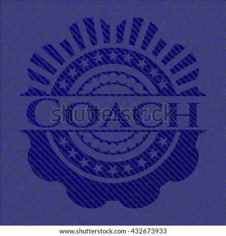 Coach badge with denim background