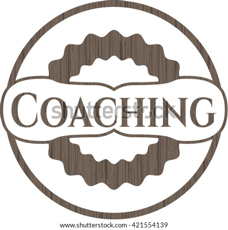 Coaching badge with wooden background