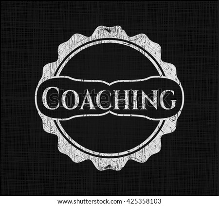 Coaching chalkboard emblem written on a blackboard