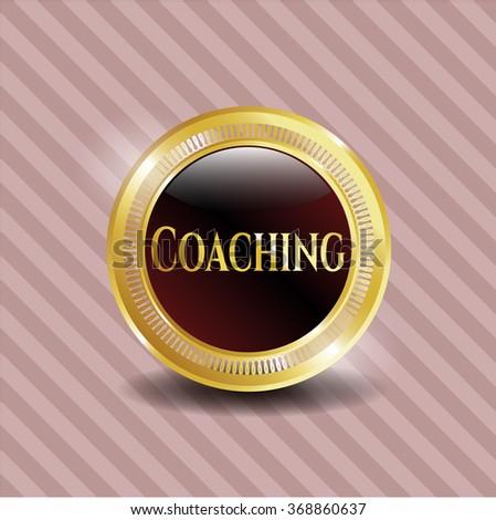 Coaching gold badge or emblem