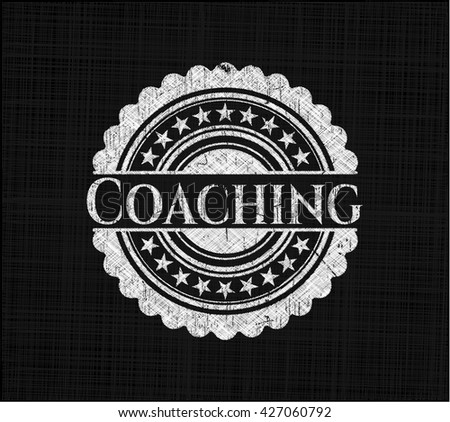 Coaching on chalkboard