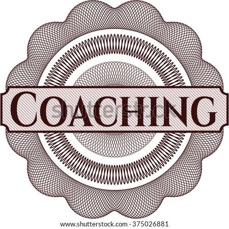 Coaching written inside a money style rosette