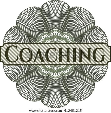 Coaching written inside rosette