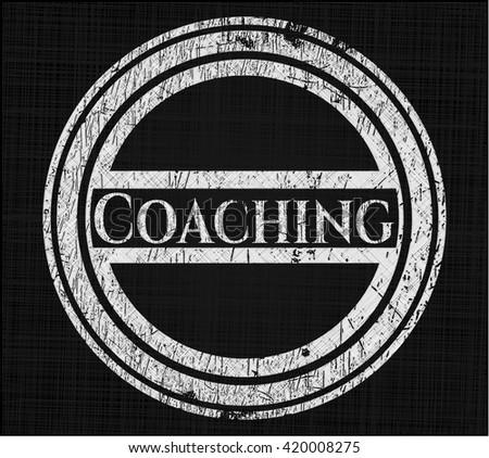 Coaching written on a blackboard