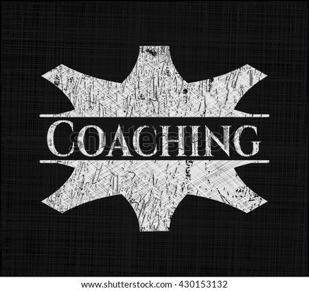 Coaching written on a chalkboard