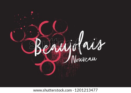 Coated Beaujolais Nouveau wine logo on the background of wine stains. Black background