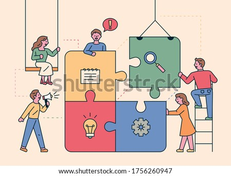 Colleagues are putting together a huge puzzle. flat design style minimal vector illustration.