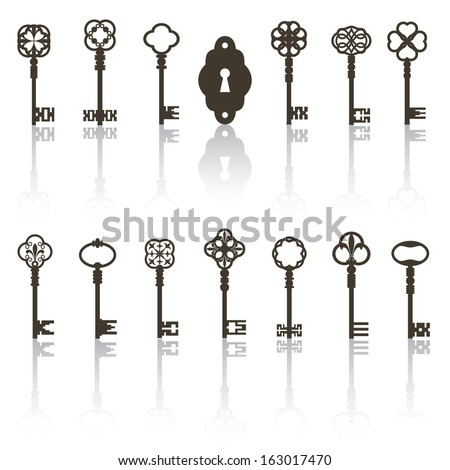Collection of antique keys, keyhole with shadows. All objects grouped separately. Foto stock ©