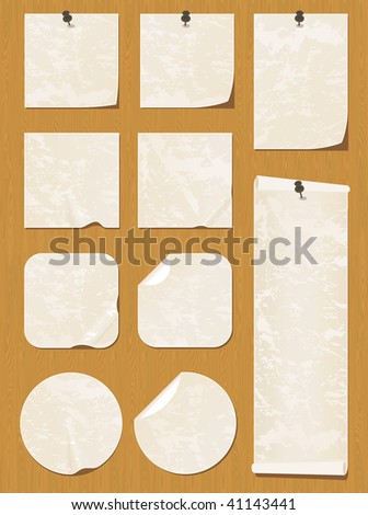 Collection of beige notes and stickers on a wooden texture.