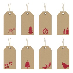 collection of brown paper tags with red christmas motifs