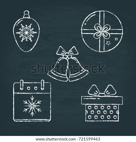 Collection of chalk sketch New Year icons on blackboard. Christmas ball, round and square gift boxes, bells with ribbon and calendar page with snowflake symbol.