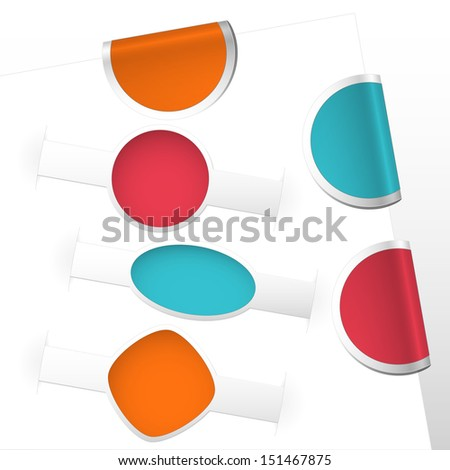 collection of curled label bookmarks and labels colored blue, red, orange