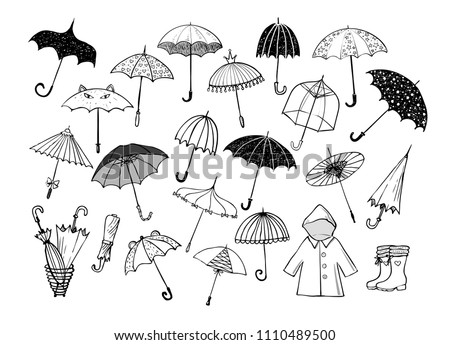 Collection of doodle sketch umbrellas on white background