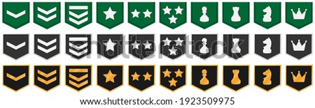 Collection of flat rank icons in shapes. Perfect for rank system in a game or app. Set with 3 types: on fabric, silver and gold Stockfoto ©