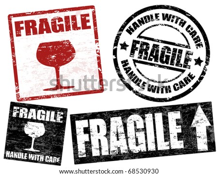 Collection of grunge office rubber stamps with word fragile written inside