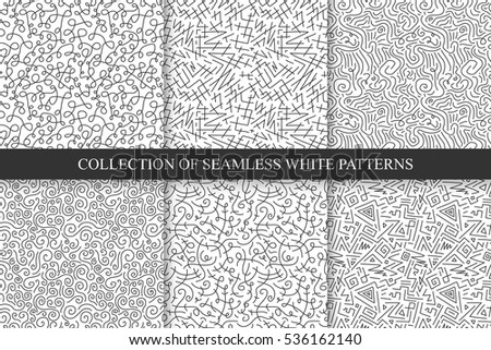 Collection of hand drawn seamless curly patterns.
