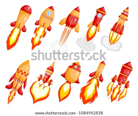 Collection of red cardboard style rockets with a jet stream on a white background. Fantastic transport isolated object. Space rocket launch. Set of starting rockets. Vector illustration