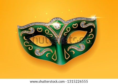 Colombina green mask decorated with diamonds. Holiday masquerade masque or decoration for face at theater, opera. Part of italian or brazil festival costume. Fashion and entertainment theme