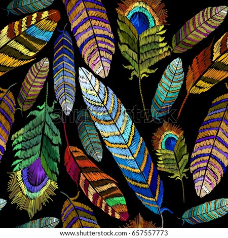Color feathers embroidery seamless pattern. Beautiful bright tropical peacock feathers embroidery, hand drawn fashion template for clothes, textiles, t-shirt design