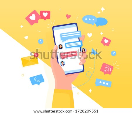 Colorful Chatting concept Hand holds a smartphone. Icons, text messages, messages, notifications fly out of the screen. Communication and conversation by phone Easily edit or overlay additional items Stock photo ©