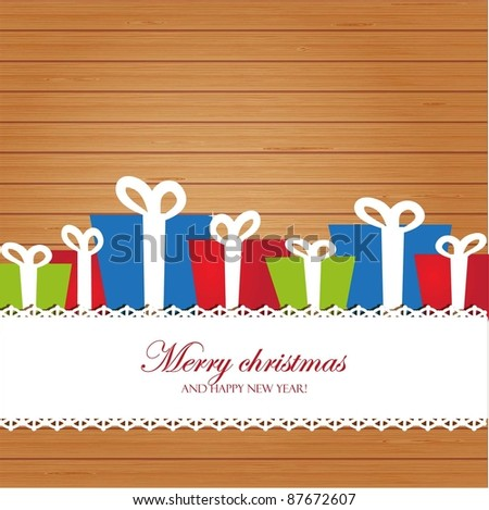 Colorful christmas boxes on wooden background
