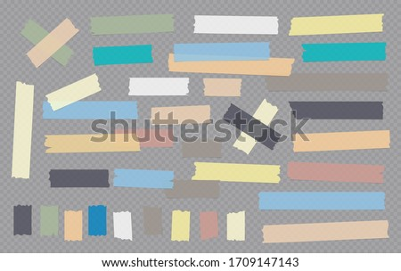 Colorful different size adhesive, sticky, masking, duct tape, paper pieces are on grey squared background