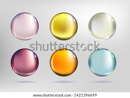 Colorful drops on white background. Serum beauty care of skin. Vitamin C or D for healthy women.