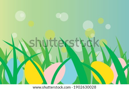 colorful easter eggs in a green
