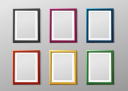 Colorful empty photo frame set hanging on grey wall - blank realistic mockup collection. Rectangle picture borders for gallery exhibition, vector illustration.