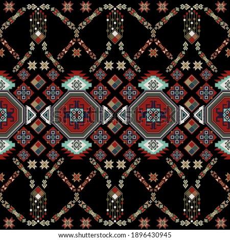 Colorful ethnic ornament, black background. Vector seamless ornamental border. Horizontal geometric ornament. Vector clipart