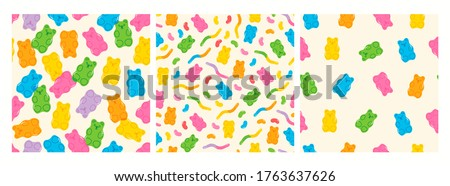 Colorful Fruity and tasty Sweets and Candies. Various Gummy and Jelly Worms, Beans, Bears. Hand drawn Vector Trendy illustration. Cartoon style. Set of three Seamless Patterns. Backgrounds, Wallpaper.