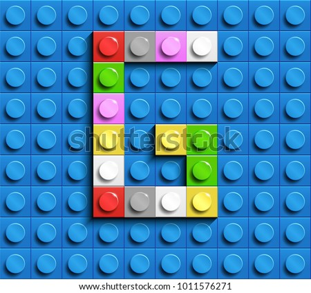 Colorful letters G of alphabet from building lego bricks on blue lego brick background. blue lego background. 3d letters G. Realistic letters