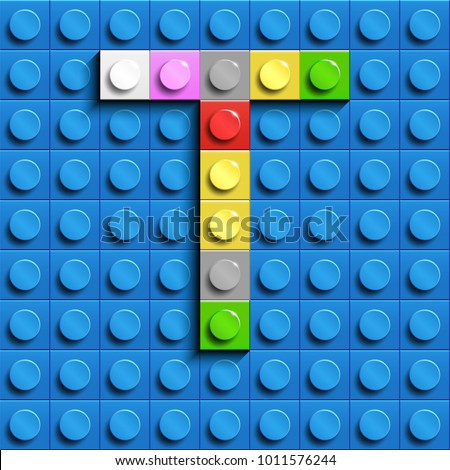 Colorful letters T of alphabet from building lego bricks on blue lego brick background. blue lego background. 3d letters T. Realistic letters