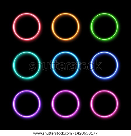 Colorful neon light ring set. Glowing colored circles background. 3d electric led or halogen lamp round frames. Technology geometric shape borders with reflection vector illustration in 1980s style.