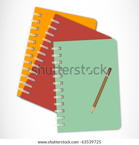 Colorful ring bound books and Pencil isolated on white Background
