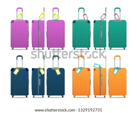 Colorful set of modern plastic suitcases with wheels, retractable handle and luggage tag label on suitcase with country code and barcode. Polycarbonate suitcases isolated on white.