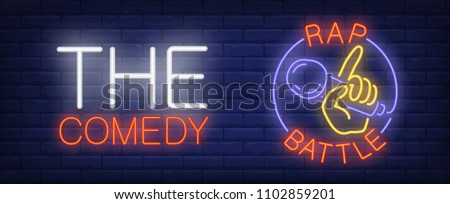 Comedy rap battle neon sign. Hand with microphone in circle on brick wall. Vector illustration in neon style for performance banner or tv show