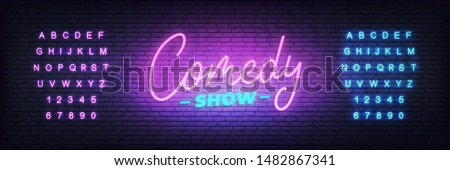 Comedy show neon. Lettering neon glowing sign for Comedy show. Stock foto ©